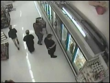 Caught on camera : A gang of thugs assault man shopping in Philadelphia Supermarket