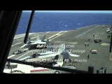 US Navy F-18 Fighter Jet is Towed Across Aircraft Carrier Flight Deck by GotFootageHD.com