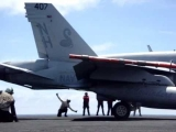 F/A-18 Hornet taking off of a Navy Carrier